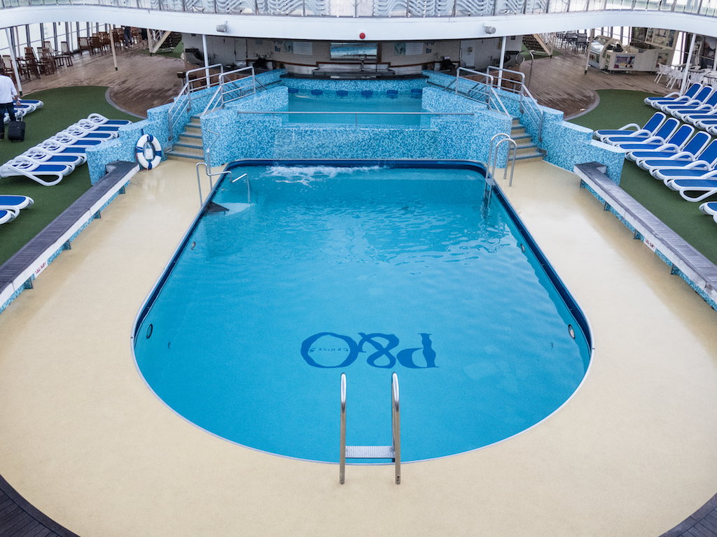 A blue swimming pool on a cruise ship