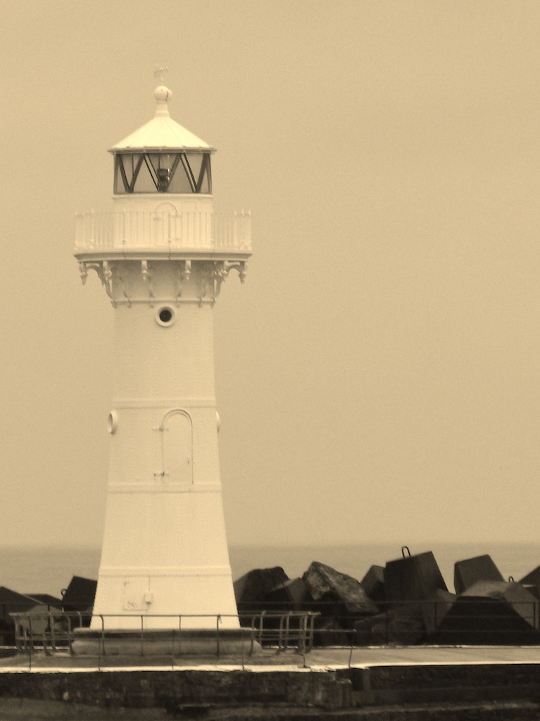 A sepia photo showing a small lighthouse
