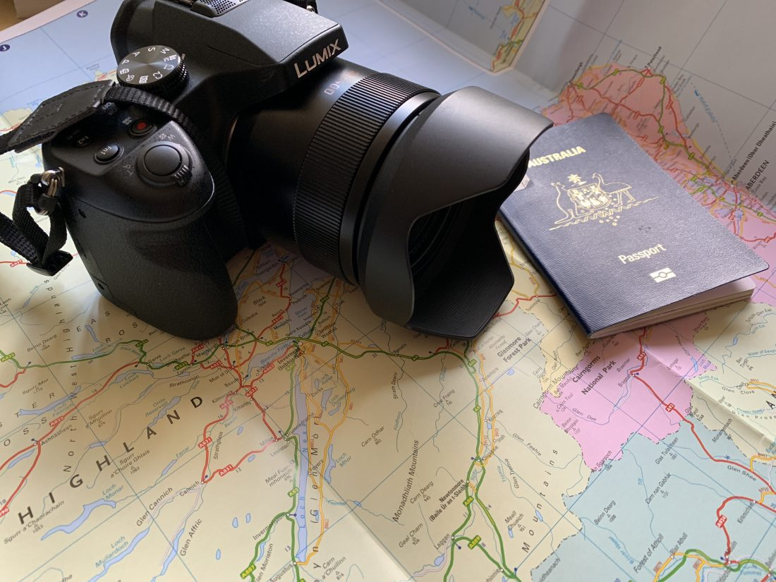A map of Scotland with Acamera and passport