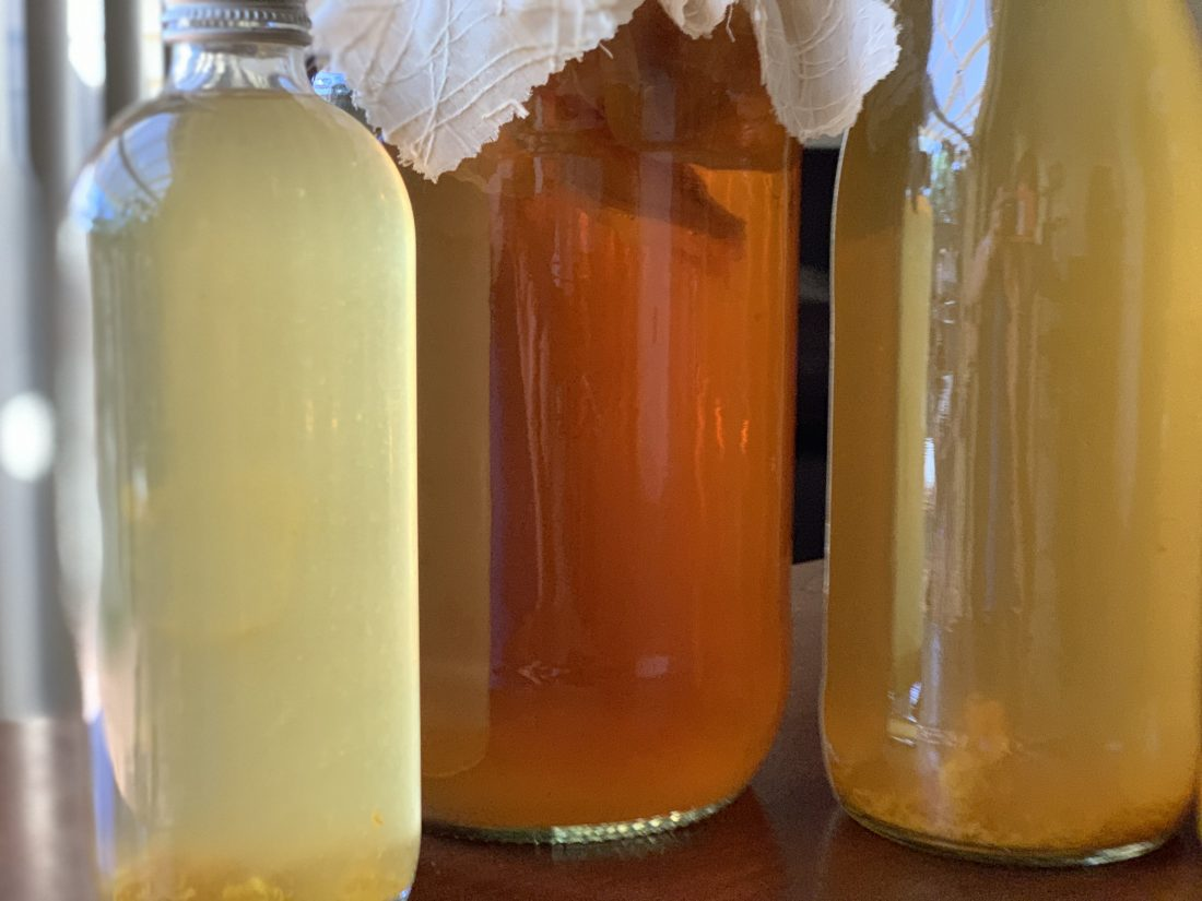 three bottles of kombucha