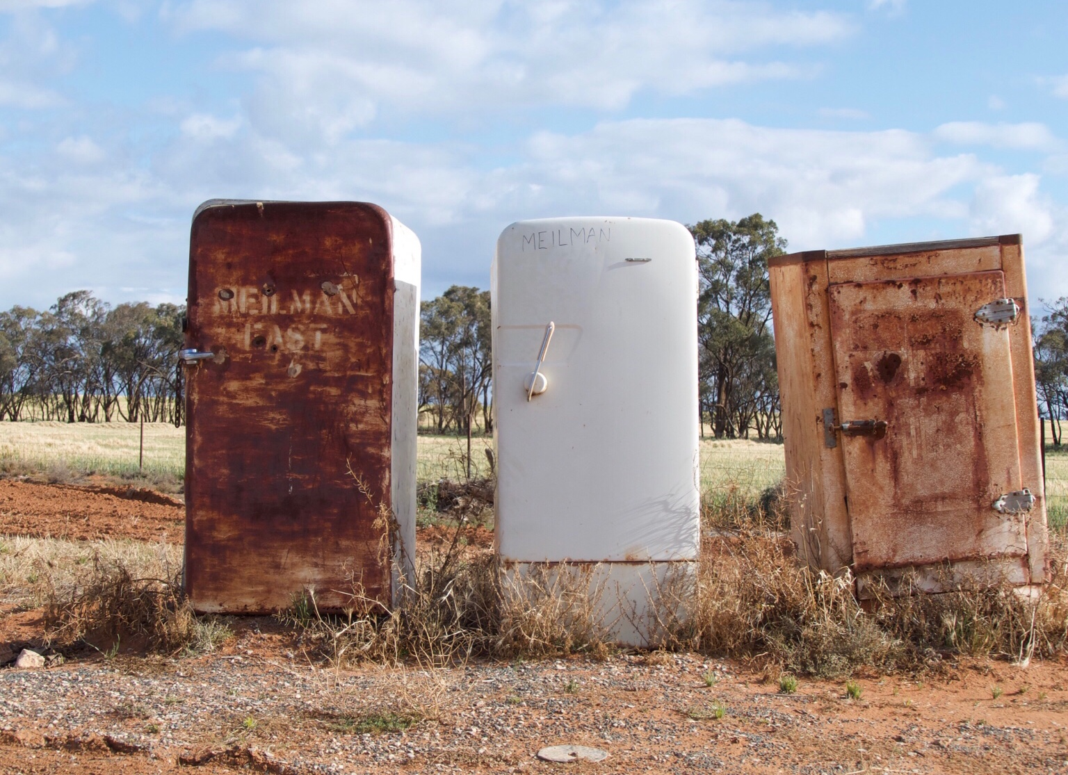 3 old fridges being used as mailboxes!